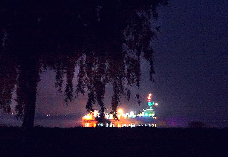 heavy ship traffic at night flowing on the Weser River