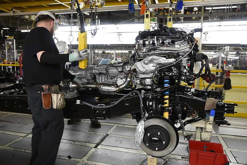 Guiding the Toyota engine and transmission into the truck chassis