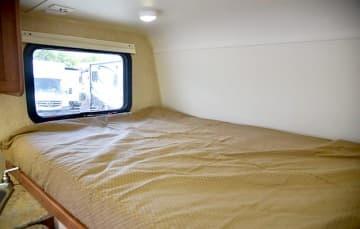 Travel Lite 625 bed on the passenger's side