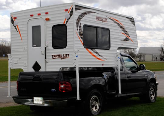 Travel Lite 625 with tailgate closed on a short bed truck
