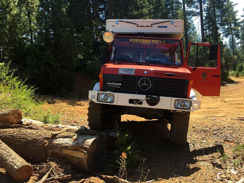 Unimog going over logs