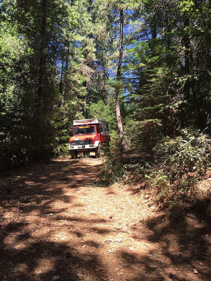 Unimog camper exploring off-road trails