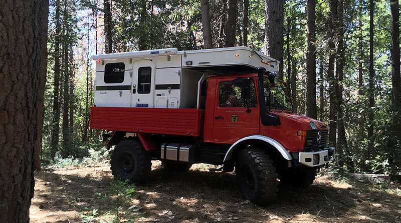 unimog-flatbed-four-wheel-camper-side-view