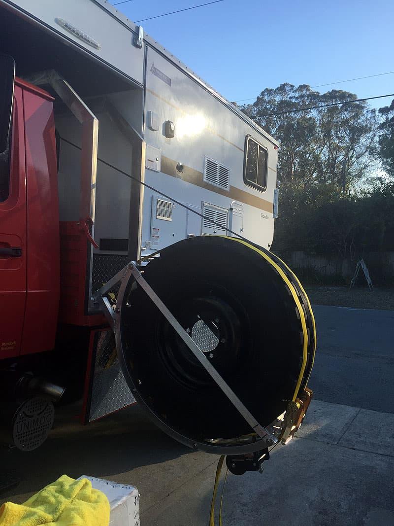 Unimog spare tire storage compartment