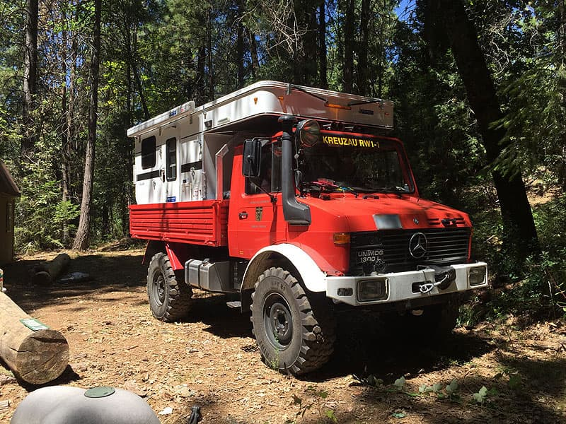 Flatbed Four Wheel Camper Grandby with Unimog truck