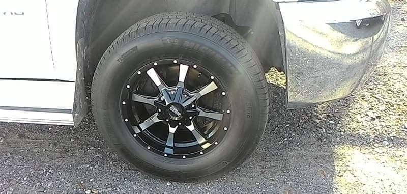 Upgraded Tires Chevy Truck With Bigfoot Camper