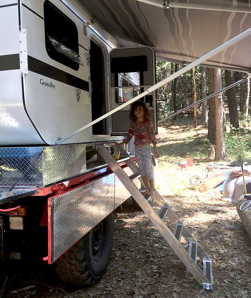 Daughter using ladder to get into Four Wheel Camper