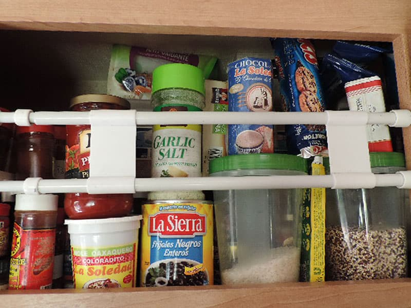 Refrigerator bars holding in containers
