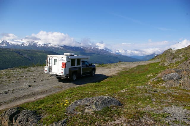 #263 - Stan and Judy FeekesAlong Richardson Highway, near Thompson Pass, north of Valdez, Alaska2015 Chevrolet 2500HD2014 Hallmark Guanella