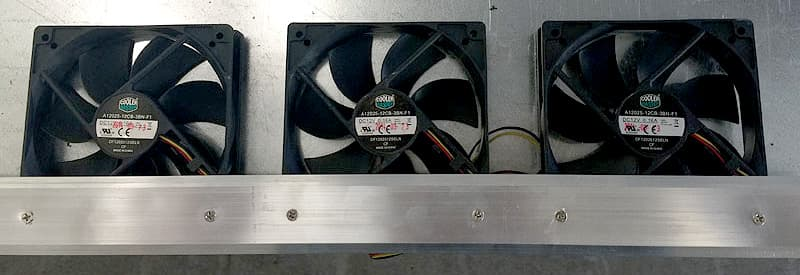 Computer fans lined up and attached to a metal bar