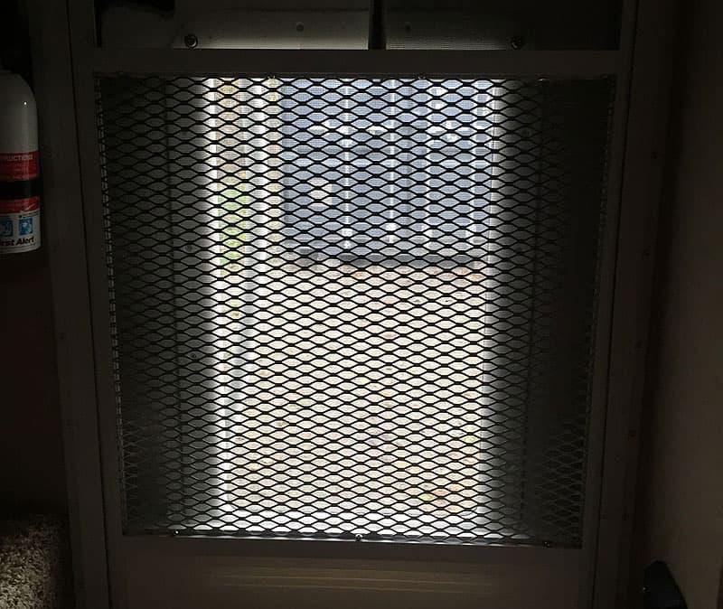 Diamond pattern screen door in camper