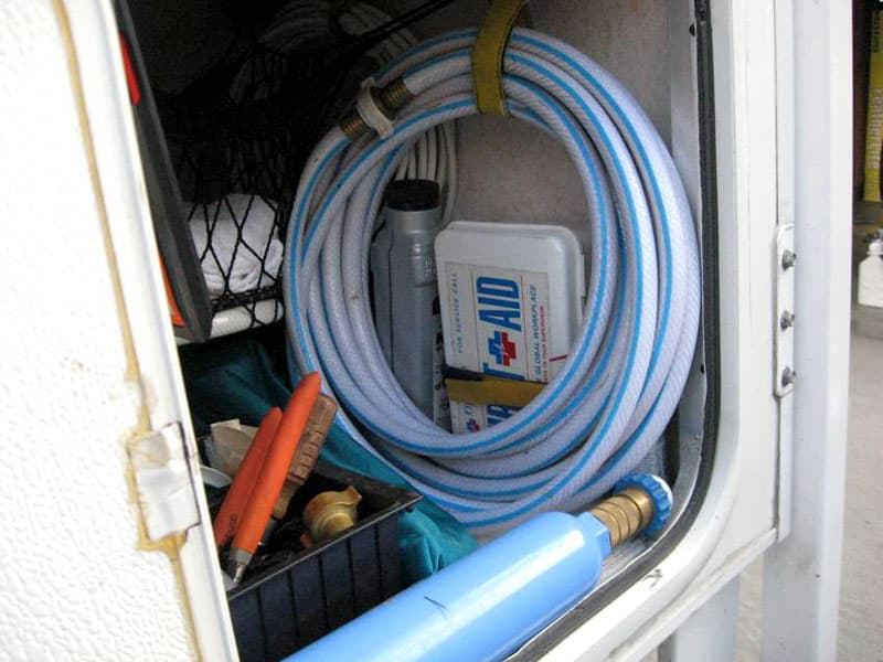 First aid kit in the outside storage area of camper