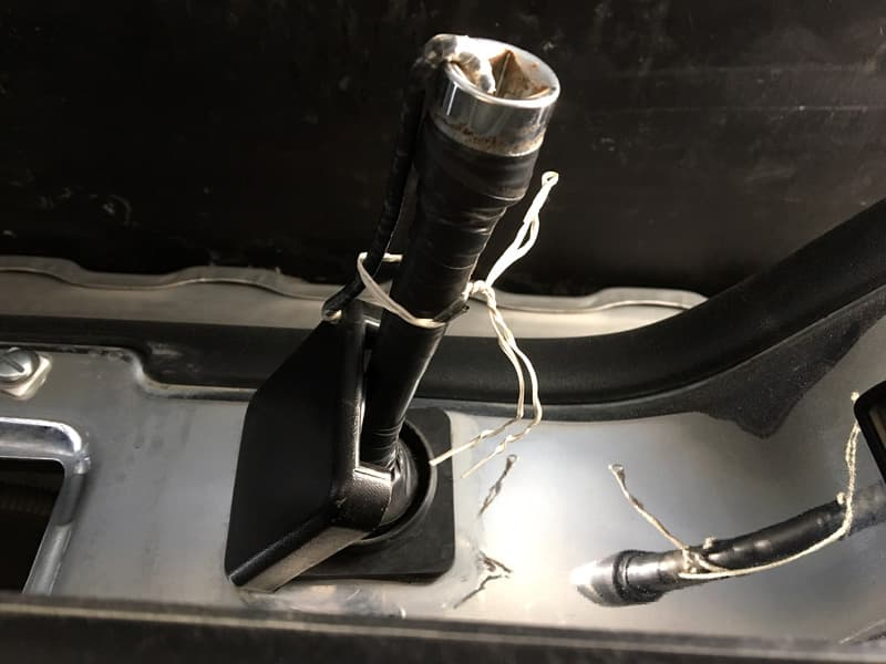 Handle for spare tire removal tool