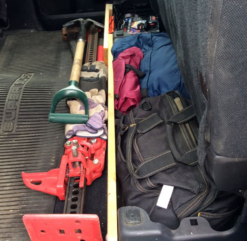 Off-road gear, shovels and jacks, in truck cab