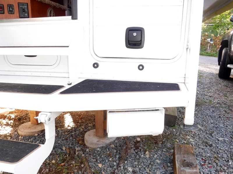 Paper towel holder on camper bumper