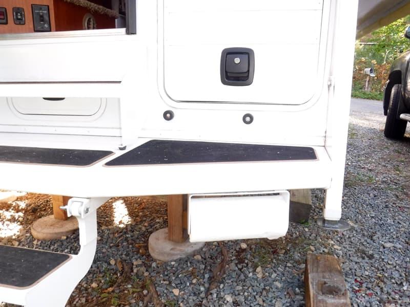 Paper towel holder on camper bumper