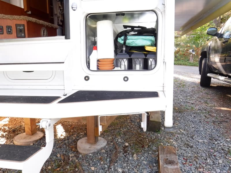 Paper towel holder on exterior camper