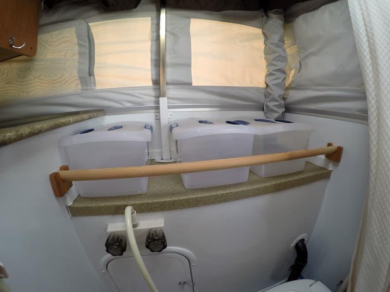 storage-boxes-bathroom-pop-up-camper