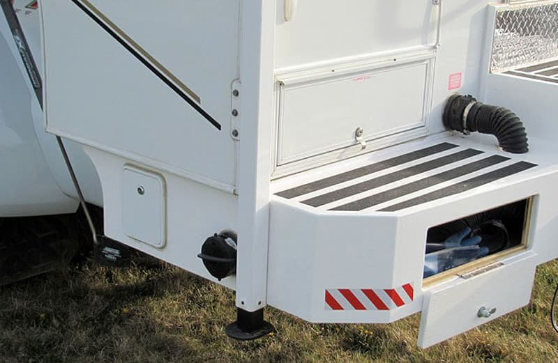 Storage bumper with grey tank integration