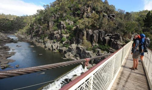 Hiking in Tasmania; Crossing the suspension bridge at Cataract Gorge, Launceston