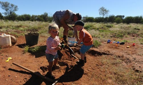 Kids digging in the dirt for gemstones
