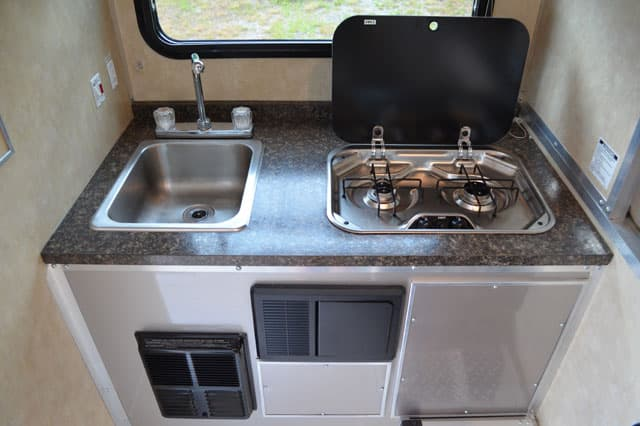 Camplite 6 8 review truck camper magazine for Camper kitchen cabinets