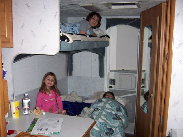 two adults, three kids, and one truck camper