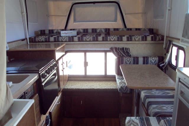 Four custom phoenix camper stories truck camper magazine for Pop up camper interior designs