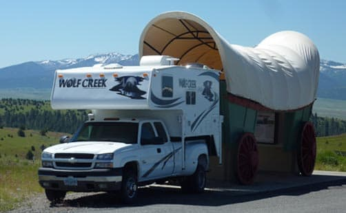 Wolf Creek and covered wagon