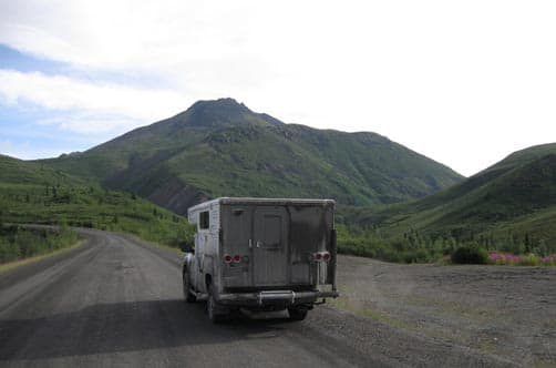 In the Yukon in a pop-up truck camper