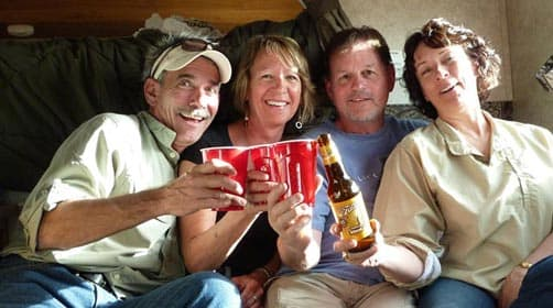 Ray, Cindy, Dennis, and Lori in the Palomino truck camper
