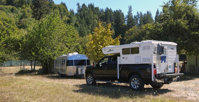 Airstream with Hallmark camper on road trip