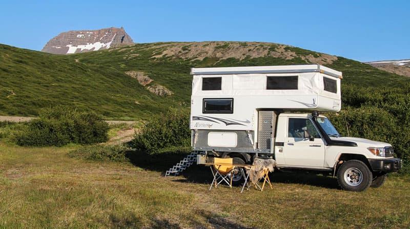 truck-camper-flatbed-toyota-preparing-dinner