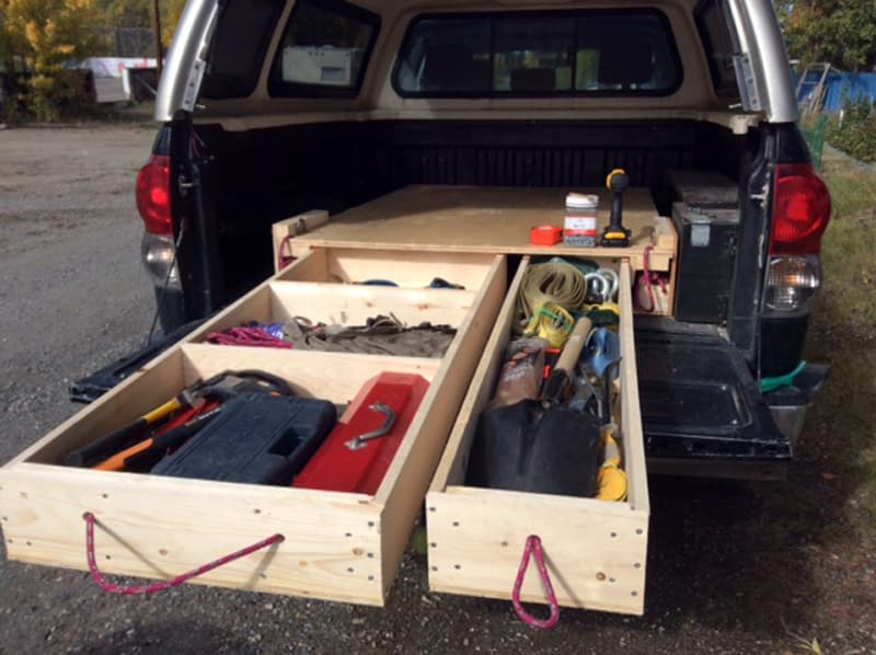 Truck canopy with storage