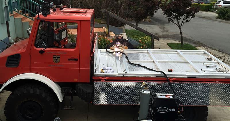 Daniel welding the platform for the Unimog flatbed truck